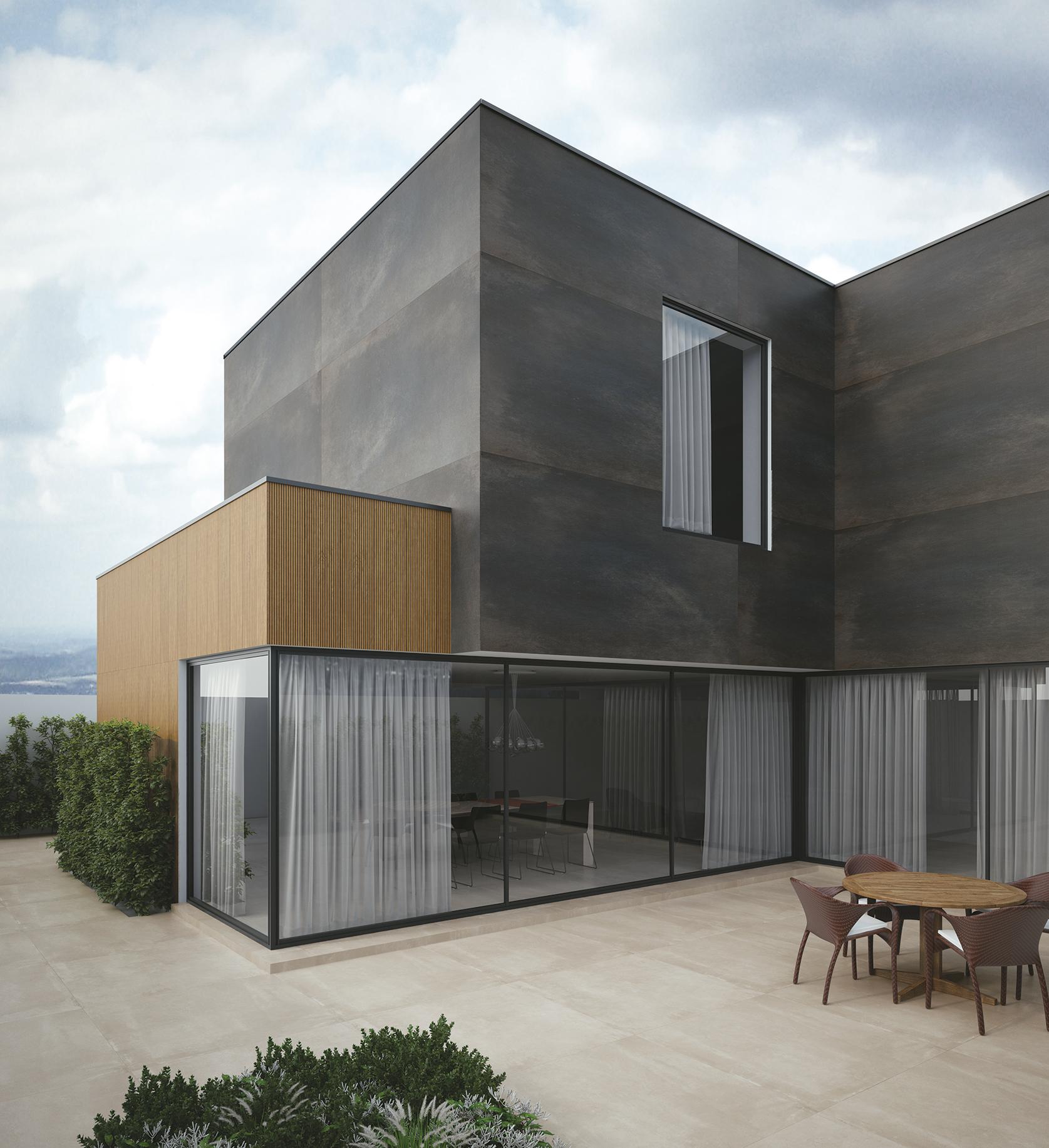 fachada revestida com produto metalizado