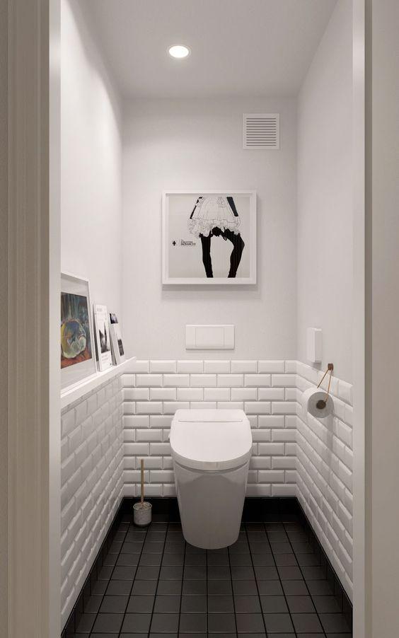 lavabo com azulejo em meia parede e piso escuro
