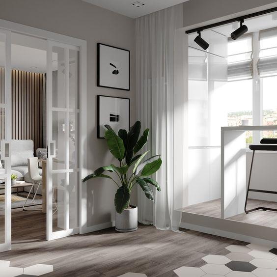 Nesta imagem temos dois ambientes dividos por porcelanato madeira e porcelanato geométrico.  De um lado a sala de estar e do outro um escritório.