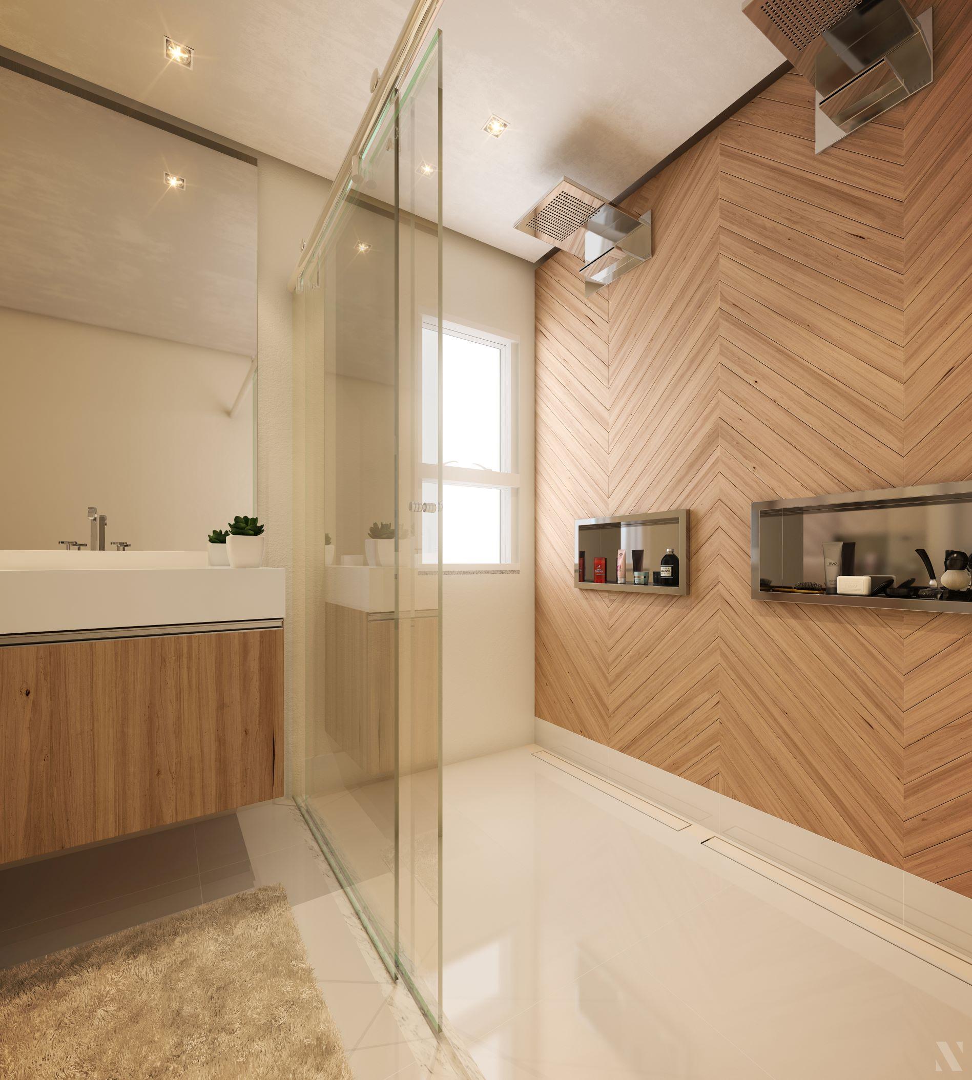 Reforma de banheiro: veja como escolher os produtos certos Sala de banho como chuveiros centrais, porcelanato que reproduz madeira, porcelanato polido e box de vidro.