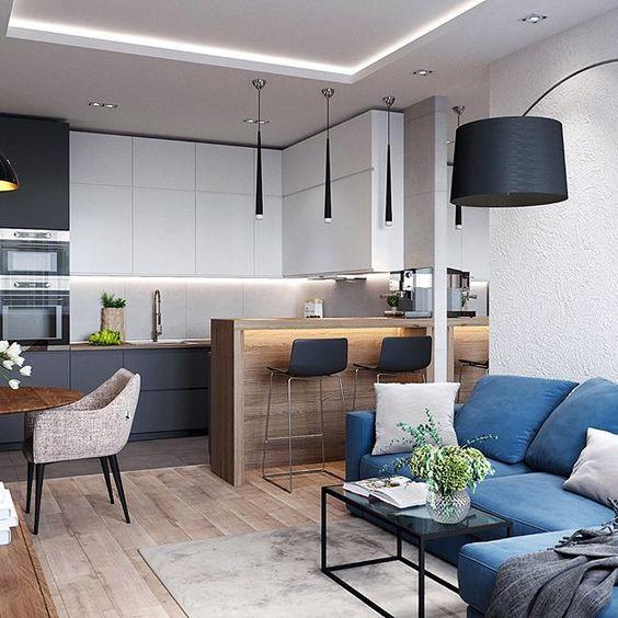 Cozinha integrada com sala de jantar. Projeto moderno com armários que saltam da parede.