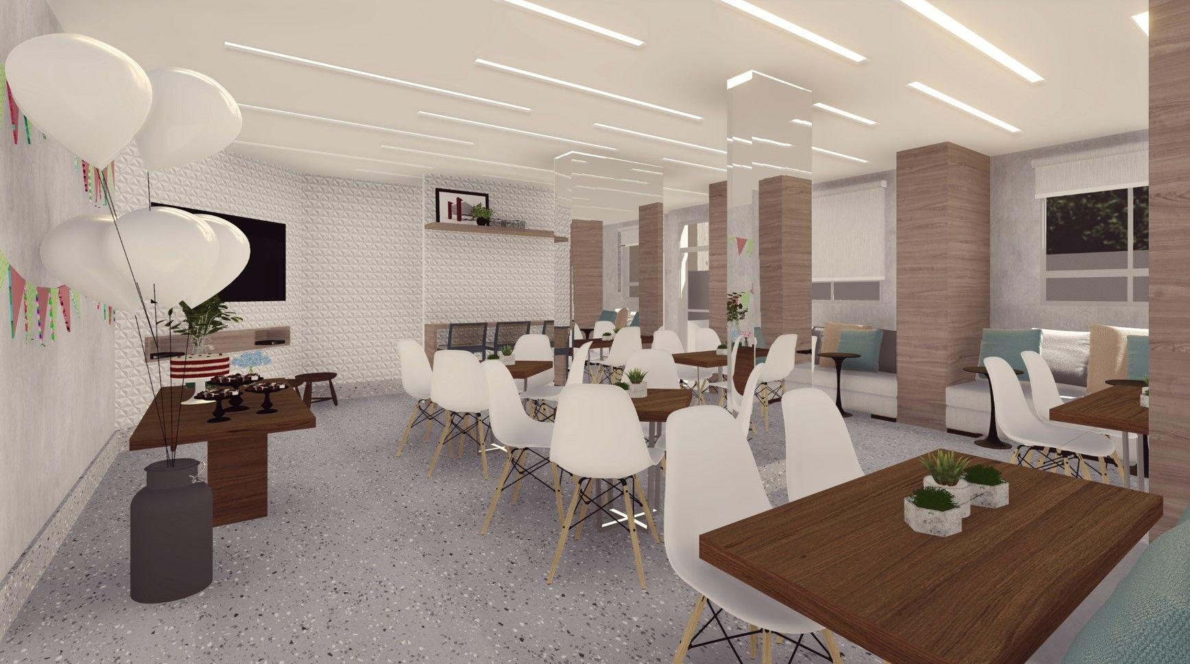Salão de festa de um prédio, com mesas e cadeiras.