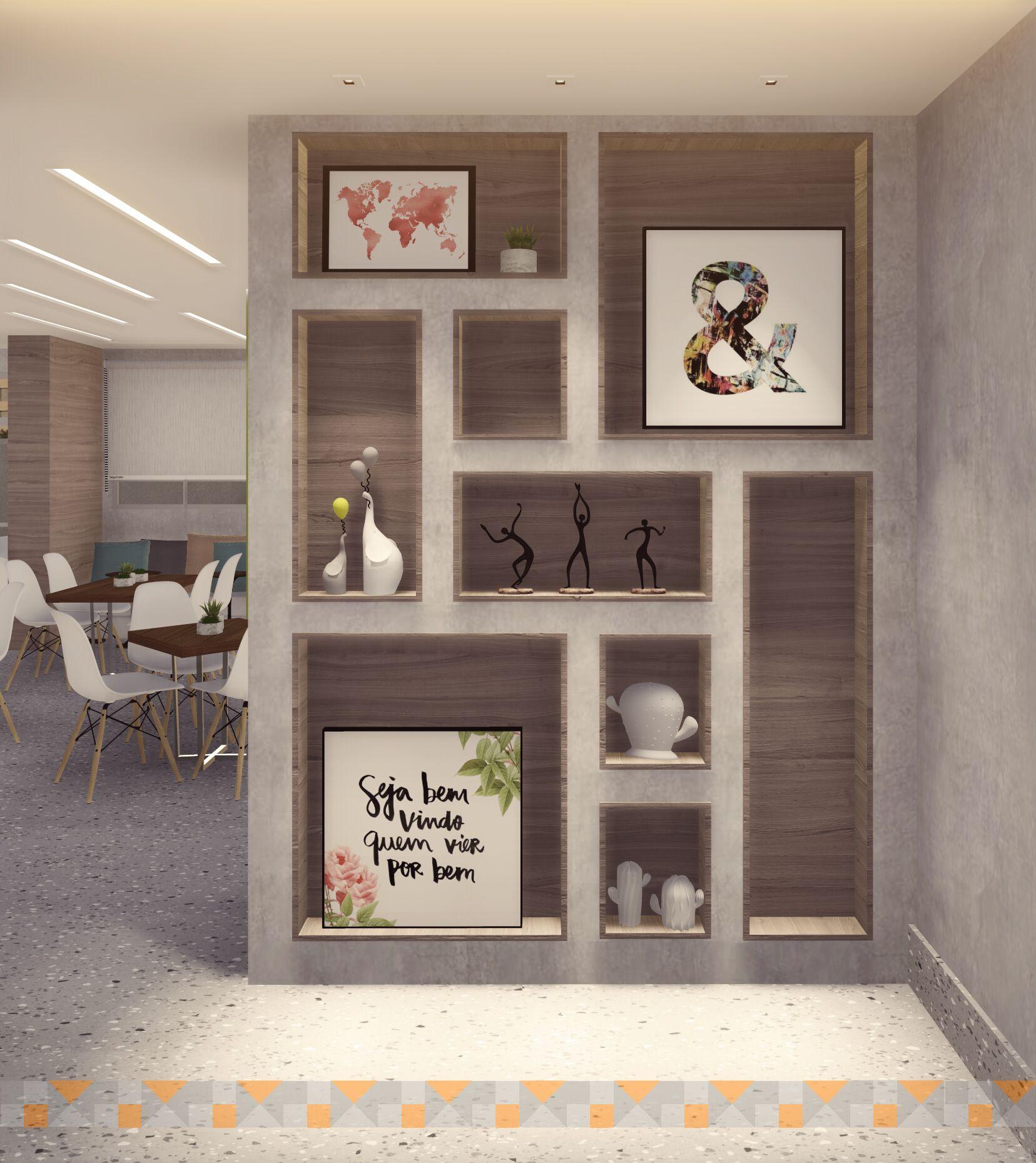 Área comum de prédio com quadros, acessórios, mesas e cadeiras.