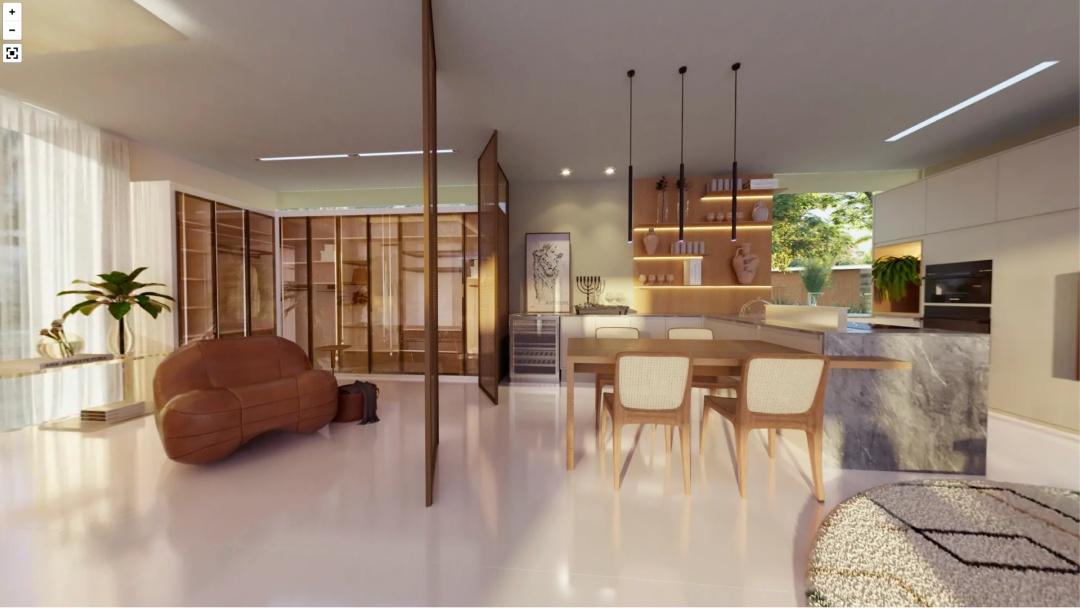 Vista da cozinha com divisória do quarto lado que está a poltrona e armário.