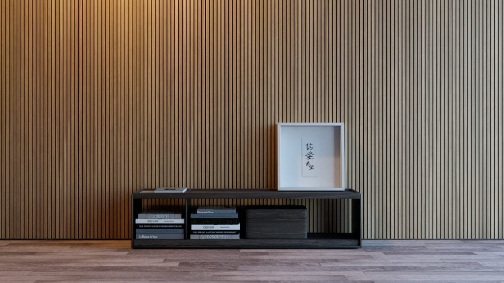 tendências de revestimentos e decoração para 2021 - ambiente com revestimento de madeira ripada na parede, piso de madeira e móvel pequeno de madeiro com livros e quadros.